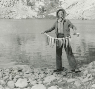 <p><span>Agnes Scott Train with a string of rainbow trout, Lamoille Lake, Ruby Mts., Nevada, August 1940, photograph by Percy Train, HI Archives portrait no. 4.</span></p>