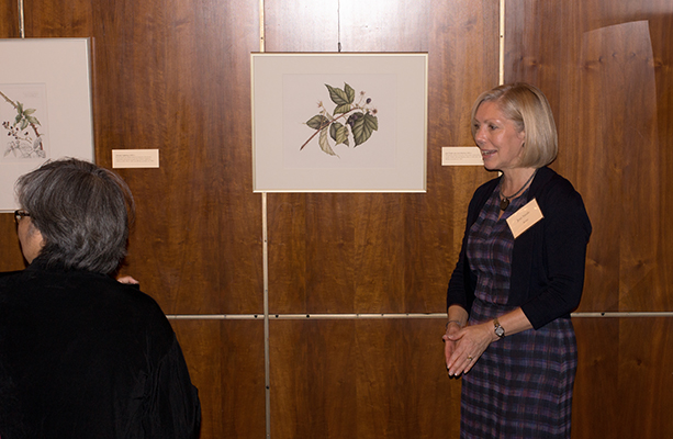 <p>Artist Jeni Neale, with her watercolor of <em>Rubus</em> Linnaeus, opening reception for <em>Dangerous Beauty: Thorns, Spines and Prickles</em>, 18 September 2014, photograph by Frank A. Reynolds, reproduced by permission of the photographer.</p>