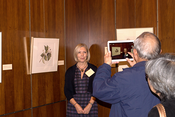 <p>An attendee photographs artist Jeni Neale, opening reception for <em>Dangerous Beauty: Thorns, Spines and Prickles</em>, 18 September 2014, photograph by Frank A. Reynolds, reproduced by permission of the photographer.</p>