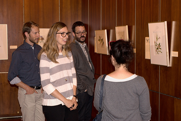 <p>Assistant Curator of Art Carrie Roy <em>(center)</em> and her husband Mike Roy <em>(center right)</em>, discuss the exhibition with visitors, opening reception for <em>Dangerous Beauty: Thorns, Spines and Prickles</em>, 18 September 2014, photograph by Frank A. Reynolds, reproduced by permission of the photographer.</p>