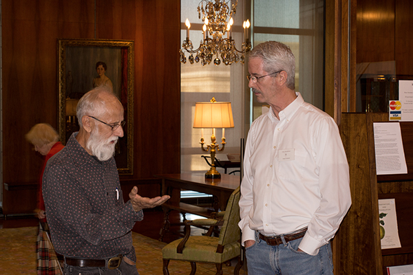 <p><em>From left</em>, J-P Malocsay and Operations Coordinator Gary Boardman, opening reception for <em>Dangerous Beauty: Thorns, Spines and Prickles</em>, 18 September 2014, photograph by Frank A. Reynolds, reproduced by permission of the photographer.</p>