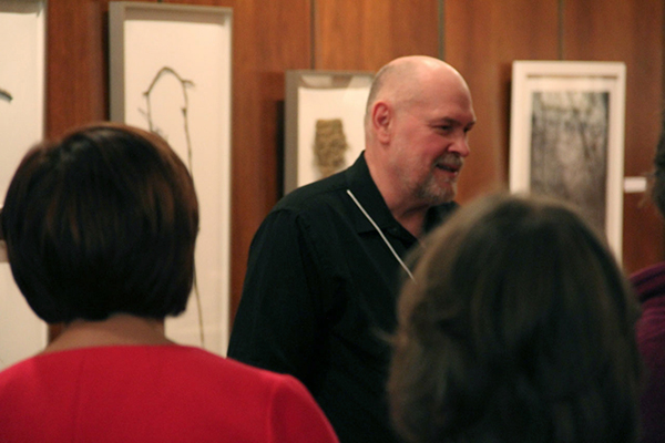 <p>David Morrison discussing his work at the <em>Elements</em> opening reception, 19 March 2015, photograph by Mike Roy, reproduced by permission of the photographer.</p>