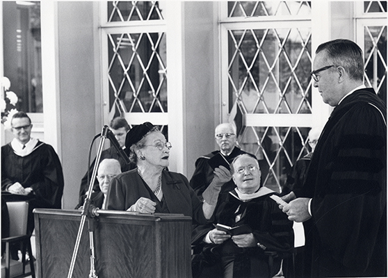 <p>Rachel Hunt (1882–1963), presenting key to the library to James M. Bovard, chairman of the Board of Trustees of Carnegie Institute of Technology, Dedication Day exercises, 10 October 1961, photograph by an unknown photographer, HI Archives Institutional Archives collection, Dedication Day October 1961 album, photo 13. <em>Seated, from left</em>, Kenneth Fagerhaugh, librarian of the Hunt Library; Roy Hunt; and John C. Warner, president of Carnegie Institute of Technology.</p>